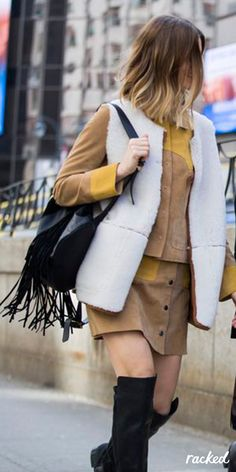 Shearling Vest Worn Over A Suede Suit and a Black Fringe Bag at Fashion Week // More Winter Style Ideas from NYFW Fall 2016 Street Style: (http://www.racked.com/2016/2/12/10966400/nyfw-street-style-fall-2016)