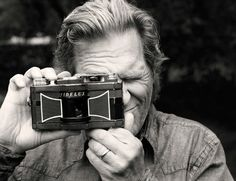 Jeff Bridges with his trademark Widelux panoramic camera. Check out some of the amazing images her takes with this at http://www.jeffbridges.com/photojan10a.html