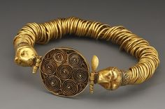 A COILED-WIRE BRACELET WITH FELINE-HEAD TERMINALS D. 8 cm. Gold Greco-Thracian, 4th-3rd cent. B.C. — with Denise Pimentel and Şakir Akasya.