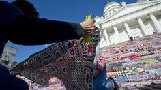 Helsinki, Finland. October 1, 2011.  Church steps covered with 152 000 granny squares made into 3800 blankets. The blankets were later donated.