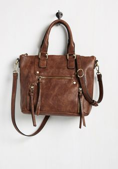 At the Carry Least Bag in Brown. Some fashionistas whove toted this brown purse have been met with smiles. #brown #modcloth