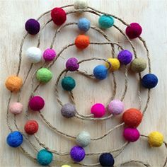 felt ball garland - I ended up using the technique where you make a ball of yarn, cover with roving, put in an old stocking and tie off each ball, then wash in hot water and tumble dry. Came out amazing!