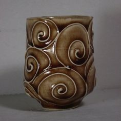 Brown vase with slip trailed decoration, glaze broken over raised areas...waterfall brown?