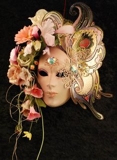 """Primavera Mask"", €1,152.00    ~ Hand-decorated mask, made in Venice according to traditional artisan techniques. Innovative colouring technique coupled with new materials, with a variety of shapes; decorated with flowers and Swarovski crystals. Satin ribbon ties to fit the mask comfortably."
