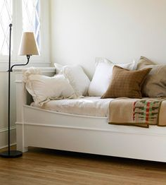 Daybeds have split personalities. They are dressed for use as a sofa by day but include a twin-size mattress for sleeping at night. Daybeds look at home in a family room or den as well as in a bedroom. A metal or wood frame may enclose three sides. Most often used to accommodate guests, daybeds sometimes conceal a pop-up frame or drawer trundle underneath that houses another mattress./