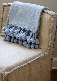blanket stitched..slip-covered chairs & s pom pom blanket