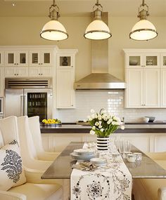 White kitchen with stainless steel details - love the look but the way I cook those chairs would smell like garlic.