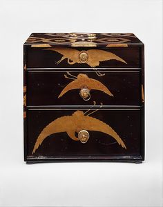 Cabinet with Design of Stylized Tortoiseshell Patterns, Momoyama period (1573–1615)  late 16th–early 17th century  - Powdered gold (maki-e) on black lacquer; gilt-bronze handle, lock, and hinges