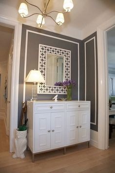 "you could totally remake this mirror using the ""Oriental 1"" lattice from Home Depot and some molding"