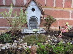 An abandoned bird house becomes a lovely Fairy Garden home!