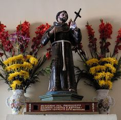 Saint Francis Puebla  This statue of San Francisco is decorated with flowers in the church at Altepexi Puebla Mexico