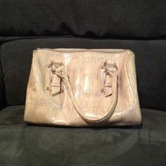 Great tan faux croc handbag w/ silver hardware This great medium sized bag has been used several times, it's just a cute kick around bag for daily use, there are a few minor blemishes, however the inside is clean. Bags