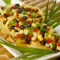 Pineapple Salsa:   Ingredients:         1 cup finely chopped fresh pineapple...      1/2 cup diced red bell pepper...      1/2 cup diced green bell pepper      1 cup frozen corn kernels, thawed...      1 (15 ounce) can black beans, drained and rinsed....      1/4 cup chopped onions...      2 green chile peppers, chopped...      1/4 cup orange juice...      1/4 cup chopped fresh cilantro...      1/2 teaspoon ground cumin...