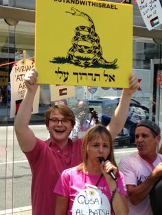 Israel supporter photo-bombs nutcase Medea Benjamin of CODE PINK during an anti-Israel protest.
