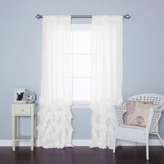 Soft flowing sheer white ruffle curtains will bring in the natural light while providing privacy!