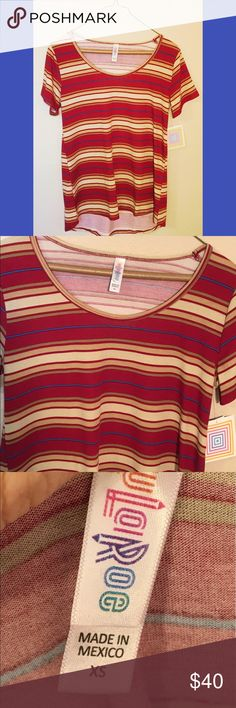 NWT LulaRoe striped scoop neck classic T Sz. XS NWT LulaRoe burgundy and gold & blue striped scoop neck classic T. Size X small.  Fits a 2-4. Short sleeve, scoop neck, soft spun poly blend. 96% poly 4% spandex. Pair with any legging or LulaRoe skirt. Great comfortable staple. #lularoe #nwt #classic #tee #scoop #new ❌no trades❌ LuLaRoe Tops Tunics
