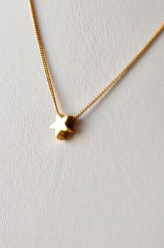 Hey, I found this really awesome Etsy listing at https://www.etsy.com/listing/178205458/golden-star-necklace-gold-filled-star