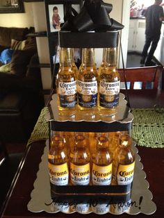 Corona birthday cake. Top layer 6 mini corona bottles. Bottom layer 12 regular corona bottles. Could use any other beer bottles.