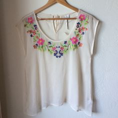 Lauren Conrad sheer floral shirt NWT sheer floral blouse. Has tag but there's two small rips along back color of shirt, see last photo. Other than that, like new. Lmk any questions. LC Lauren Conrad Tops Blouses