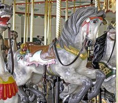 The 1914 PTC #33 Carousel at Como Park St.Paul, MN Model: #33  Horses in the inner rows are almost as fancy and dramatic as the horses of the outer row. This is a second row jumper.