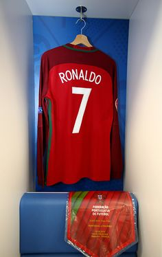 The shirt worn by Cristiano Ronaldo of Portugal is hung in the dressing room prior to the UEFA EURO 2016 quarter final match between Poland and. Football Dress, Uefa Euro 2016, 2016 Pictures, World Football, European Championships, Cristiano Ronaldo, Dressing Room, Poland, Portugal