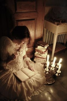 """""""She read, book after book, burning midnight oil with reckless abandon, forgetting the time, and walking into a land that knew no pain."""""""