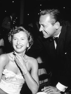 Barbara Stanwyck shares a smile with William Holden, 1951
