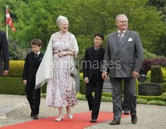 Queen Margrethe II of Denmark, Prince Consort Henrik of Denmark, Prince Nicolai (R) and Prince Felix (L) attend the christening of Princess Athena of Denmark at Mogeltonder Church on May 20, 2012 in Tonder, Denmark.