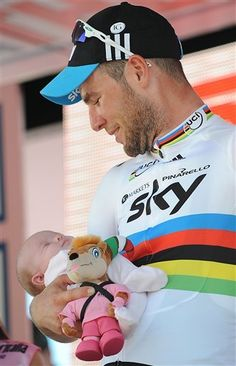Britain's Mark Cavendish holds his daughter Delilah Grace on the podium after winning the fifth stage of the Giro d'Italia, Tour of Italy cycling race, from Modena to Fano, Italy, Thursday, May 10, 2012. World Champion Mark Cavendish won the fifth stage of the Giro d'Italia on Thursday, but there was more bad luck for Taylor Phinney as the American was caught up in another crash on the 199-kilometer leg from Modena to Fano.