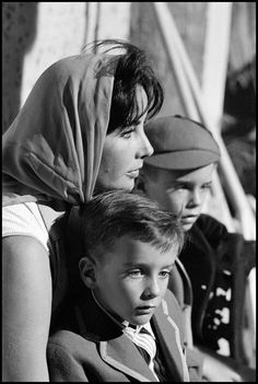 "Elizabeth Taylor with her sons Christopher and Michael on the set of the film ""Suddenly Last Summer"" in Sagaro, Spain, 1959."