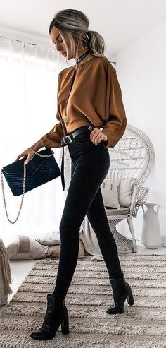 #winter #outfits women's brown long-sleeve blouse and black skinny jeans