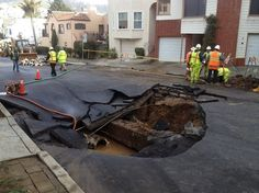 Crews pump water from the sinkhole that appeared on 15th Avenue near Wawona Street in San Francisco when a water main broke early Wednesday. Photo: Will Kane, San Francisco Chronicle