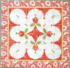 """Cabin Fever  - Jill Finley of Jillily Studio - Finished size: 54"""" x 54"""" - In this cute quilt, the traditional log cabin block is bumped up a bit creating a curvy block. It is laid out in a scalloped edge pattern framing the quilt center, where the bright flowers invite us outside into the sun."""