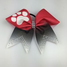A personal favorite from my Etsy shop https://www.etsy.com/listing/277914648/cheer-bow-red-ombre-to-black-w-white-paw