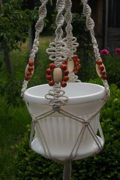 Handmade macrame plant hanger - decor for home and garden.  Macrame cord 100% cotton 3 mm and wood beads. Length 40. Diameter flower pot 7-8.