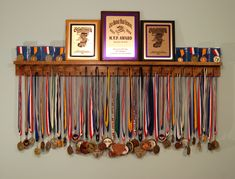 4 Ft Award Medal Display Rack accommodates 37 Lanyard Medal Awards,  and has a grooved Trophy shelf for cased Medal display, Plaque display,...