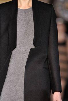 black coat, grey top