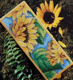 Made by Marian. Bookmark sunflower embroidered on plastic canvas. A 'Royal Paris' cross stitch Bookmark kit.