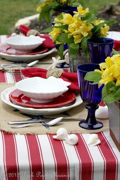 Red, white and blue tablescape. This would be a fun look for of July/Memorial Day/Veterans Day outdoor party! Love the red and white striped tablecloth! Fourth Of July Decor, 4th Of July Decorations, July 4th, Deco Table, A Table, Beautiful Table Settings, Table Arrangements, Holiday Tables, Decoration Table