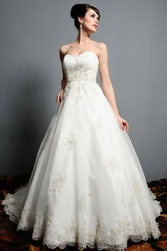 Eden Bridals wedding dresses – Gold Label 5109 The full pick-up skirt has been accented with matching beaded flowers all around to the chapel train. Description from weddingfashioning.com. I searched for this on bing.com/images