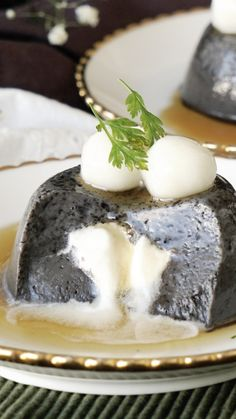 Topped with mochi and maple syrup, this black sesame pudding is a sweet, creamy treat.