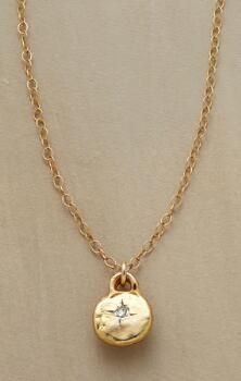 This diamond and gold pendant necklace lends a special little sparkle to any occasion. ## $98