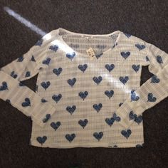 White Light Sweater With Blue Heart Detail Never worn! Has tags! Smoke and pet free! No stains rips or holes! Aeropostale Tops