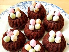 These Easter bird's nest cakes are formed of cocoa and butternut squash-based gluten-free soft bundt cakes which are filled with a rich chocolate buttercream icing and are topped with crispy-shelled chocolate-filled mini eggs. They're ideal for serving on Easter Sunday as a little treat for kids, as a tasty treat for adults with a cup of tea or coffee, or slightly warmed up in the microwave as a delicious dessert to finish your Easter Sunday meal. I'd bet even the Easter Bunny wou...