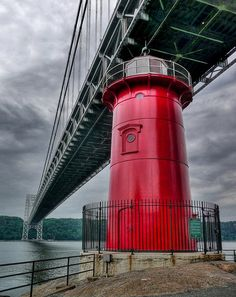 """""""Little Red Lighthouse on a dark day"""" Little Red Lighthouse Beneath the George Washington Bridge, New York City. I saw this on a boat tour around NYC- so tiny & cute! Little Italy, Little Red Lighthouse, New York City, Beacon Of Light, George Washington Bridge, Fort Washington, Washington Heights, Hudson River, Around The Worlds"""