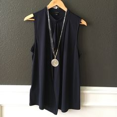 "Ann Taylor sleeveless top Chest 21"", length 27"". Great condition, maybe worn once sleevless top from Ann Taylor. It has a snap detail at the neck that can be worn open or closed. Very comfortable and roomy. Navy blue. Very comfy just a bit big on me. Ann Taylor Tops"