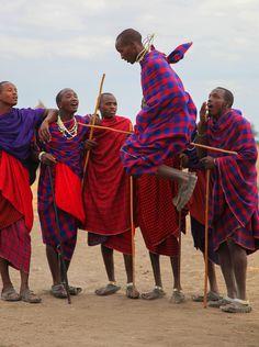 Tribesmen engaging in a traditional jumping ritual in Tanzania  http://www.mangoafricansafaris.com/