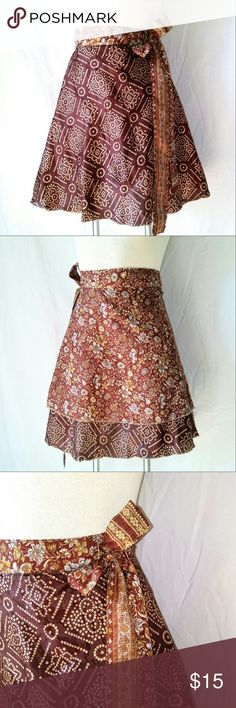 SILKY Wrap Skater Skirt Gorgeous Reversible Brown & Gold Silky Wrap Skirt. One Size Fits All. Just above knee, skater flare. No tags. In excellent used condition. From a smoke free home. Make an offer! Vintage Skirts