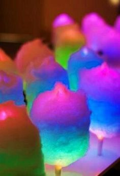 Cotton candy on a glow stick. Just wrap cotton candy around a glow stick. Super easy and fun!