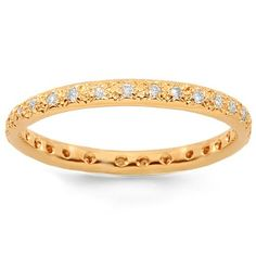 This elegant small womens diamond eternity band is crafted in highly polished 14K Rose Gold. Small round cut diamonds are pave set across the band and total to 0.50 carats. The band measures to 1/32 Inches in width and weighs approximately 1.6 grams. This lovely womens diamond eternity band is an ideal gift at an affordable value. $534.00